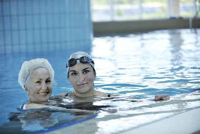 aquatic therapy older woman and physical therapist in pool